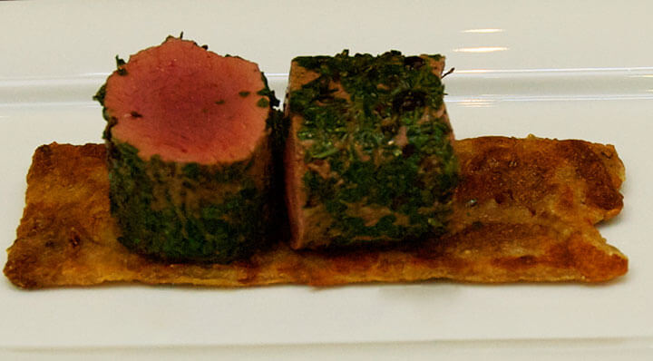 Sous vide saddle of venison coated with herbsRehruecken Bergpfeffermantel Karlheinzhauser
