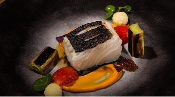 Sous vide cod with leeks, sweet potatoes and wild greensKabeljau Lauch Georgestylianoudakis